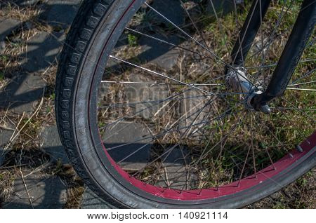 close-up of bicycle wheel and wheel spokes