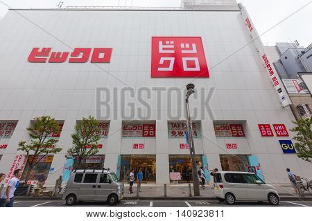 TOKYO JAPAN - 17 JULY 2016 - People walk around in front of Uniqlo store building in Shinjuku Japan on July 17 2016.