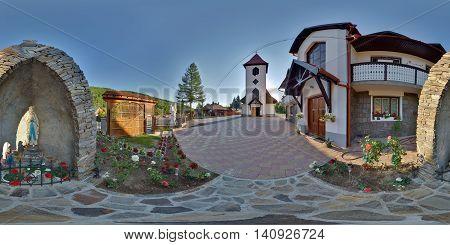 SUB CETATE, ROMANIA - July 16: 360 panorama the churchyard of Saint Joseph Catholic Church with a Mary Magdalene statue on July 16th, 2016, in Zeteváralja (Sub Cetate), Transylvania, Romania