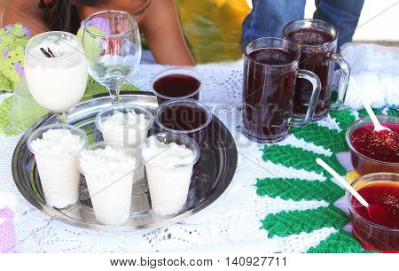 Display of rice with milk arroz con leche and other Peruvian desserts