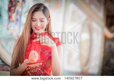 Asian Chinese Woman In Traditional Chinese Hold Gift Bag