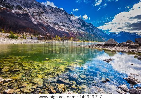 The picturesque Medicine Lake, has strongly shoaled in the fall. Jasper national park, Canada