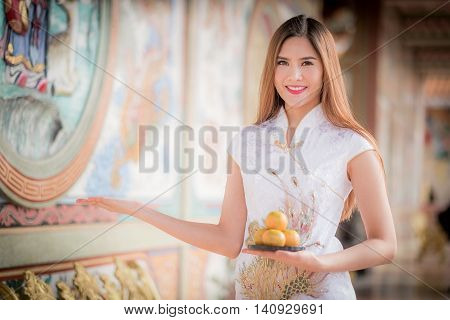 Asian Chinese Woman In Traditional Chinese Holding Orange Pay Respect