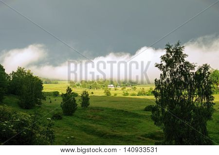 Landscape after a storm with sun and fog