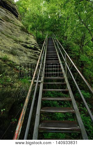 High steel ladder on the tourist route through the rock