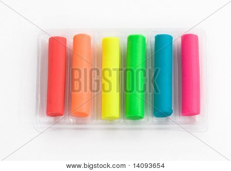 Colorful pieces of plasticine on a white background