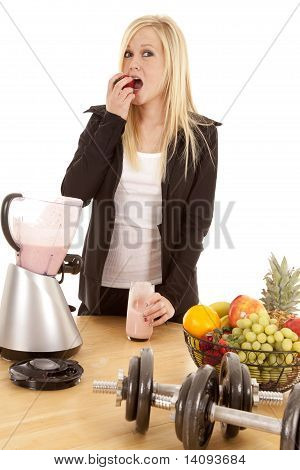 Woman Eating Strawberry By Blender