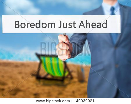 Boredom Just Ahead - Businessman Hand Holding Sign
