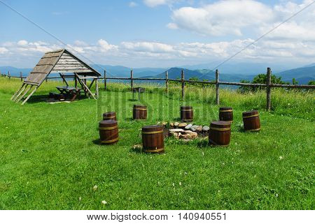 Stumps for seats in the Caucasus Mountains and gazebo