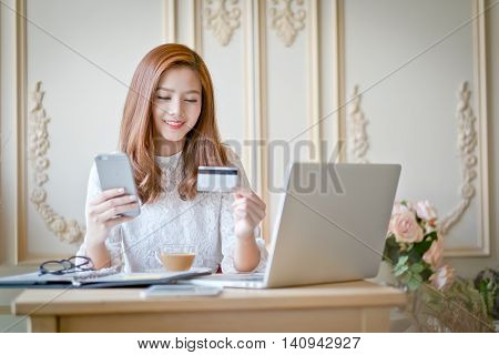 Happy Woman Shopping Online, Holding Credit Card.