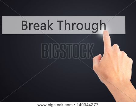 Break Through - Hand Pressing A Button On Blurred Background Concept On Visual Screen.