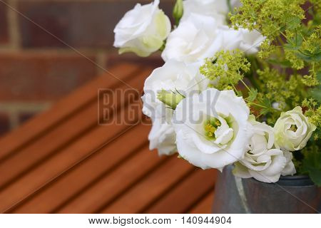 White Tulip Gentians With Ladys Mantle On A Wooden Table