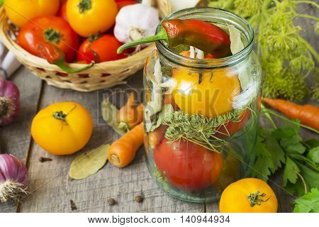 Tomatoes herbs garlic glass jar - set for home canning.