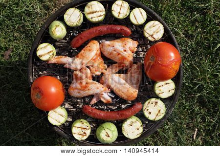 Chicken Wings And Vegetables On Grill
