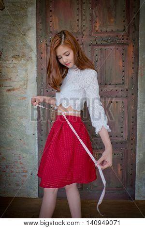 Fashion Designer Measuring Tape A Dress.