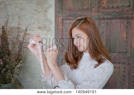 Attractive  Female Dressmaker Sketching