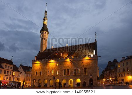 TALLINN - SEPTEMBER 10: Buildings of Town Hall Square in the night on September 10 2013 TALLINN ESTONIA. Old Town is listed in the UNESCO World Heritage List