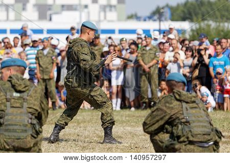 Ulyanovsk Russia - July 31 2016: Demonstrations of soldiers during the celebration of the Airborne Forces. Soldier demonstrates possession of nunchaku.