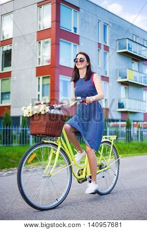 Happy Woman In Dress Riding A Bike