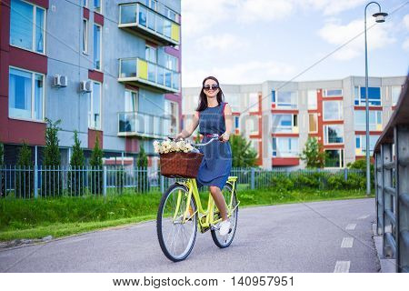 Happy Woman In Dress Riding Vintage Bike