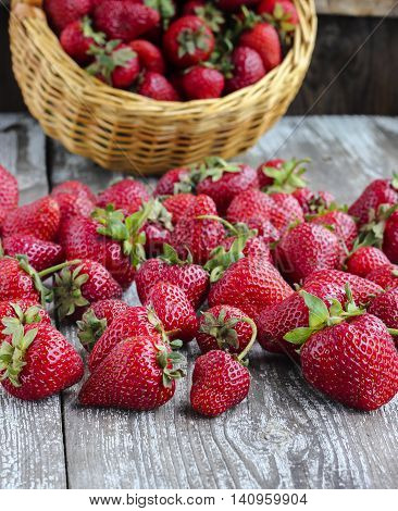 Fresh Strawberries In A Wicker Basket On A Wooden Table