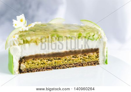 Lemon and apple cake with caramel mousse and a layer of crunchy layer