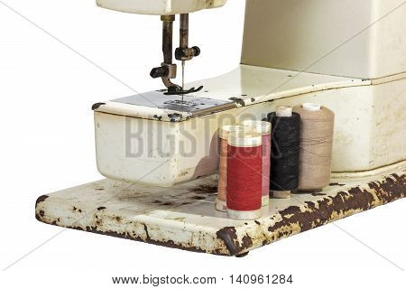 Close Up Of Arm Of Old Sewing Machine With Cottons