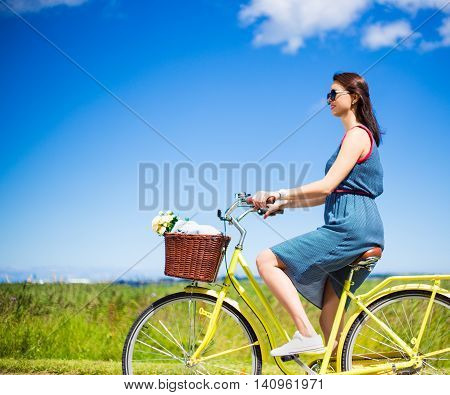 Side View Of Carefree Beautiful Woman Riding Vintage Bicycle
