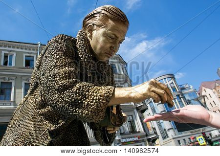 St. PETERSBURG RUSSIA - JUL 2 2016: Street actress (living statue) in the image of a greedy old woman from famous novel by Fyodor Dostoevsky