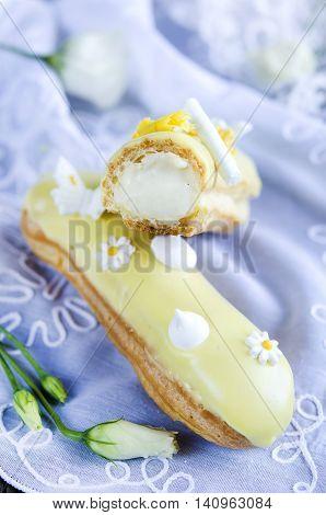 Delicious vanilla eclair with vanilla Chantilly cream