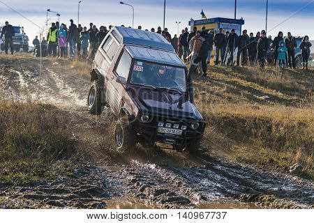 LvivUkraine- December 6 2015:Unknown rider on the off-road vehicle overcomes a route off road near the city of Lviv Ukraine