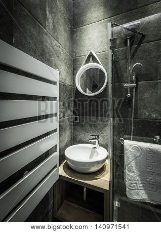 Detail Of Washbasin In A Modern Bathroom With Gray Wall