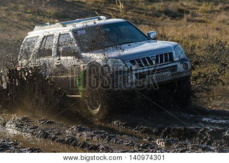 LvivUkraine- December 6 2015: Unknown rider on the off-road vehicle brand Great Wall overcomes a route off road near the city of Lviv Ukraine
