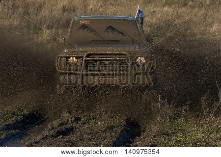 LvivUkraine- December 6 2015: Unknown rider on the off-road vehicle overcomes a route off road near the city of Lviv Ukraine
