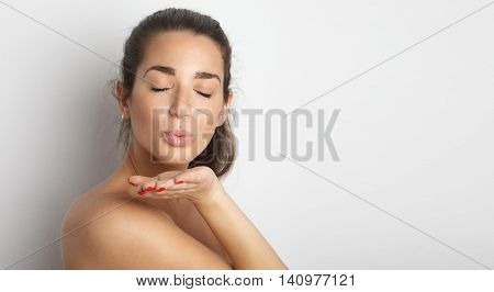 Portrait Handsome Pretty Young Woman Long Hair Gives Air Kiss Empty White Background.Beauty, Grooming, Fashion People Photo.Sexy Topless Girl Smiling Camera Studio Shot.Horizontal Wide Image