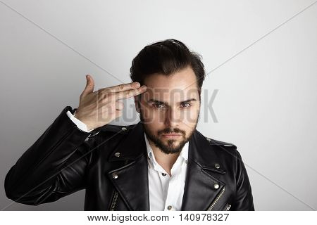 Handsome Young Bearded Man Wearing Stylish Shirt Black Leather Jacket Shot Hand Head.Beauty, Lifestyle, People Concept Photo.Adult Serious Hipster Guy Empty White Background.Horizontal