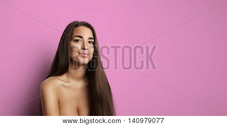 Portrait Handsome Pretty Young Woman Long Hair Empty Bright Pink Background.Beauty, Grooming, Fashion People Photo.Sexy Topless Girl Smiling Camera Studio Shot.Horizontal Wide Image.Soft Shadows Effect