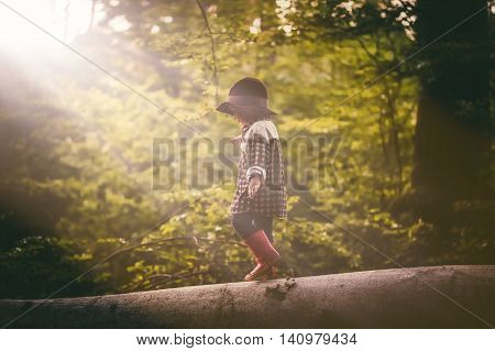 Boy In Hat Playing Outdoor In Summer Forest