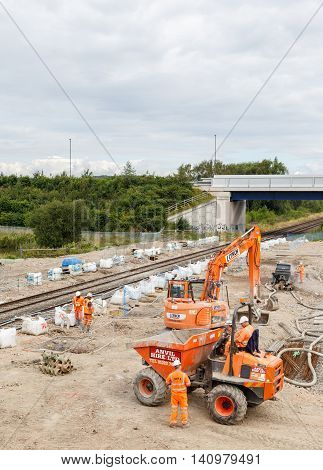 ILKESTON ENGLAND - AUGUST 1: Construction workers on site next to a section of railway track. In Ilkeston Derbyshire England. On 1st August 2016.