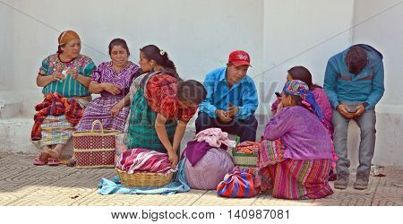 CHICHICASTENANGO GUSTEMALA APRIL 29 2016: Portrait of a Mayan women selling table cloth. The Mayan people still make up a majority of the population in Guatemala,