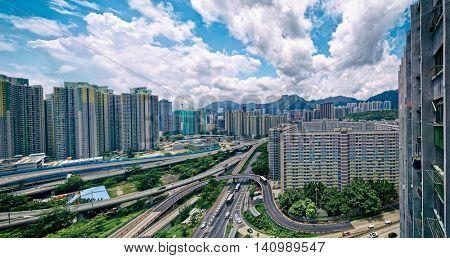 hong kong public estate buildings with landmark lion rock at day