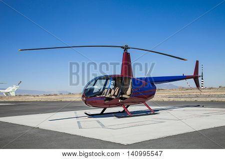 A Beautiful Helicopter parked at the helipad