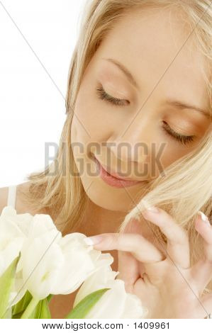 Cheerful Blond With White Tulips