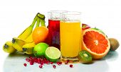 stock photo of fruit-juice  - Collection of a ripe wet tropical fruits with juice glasses - JPG