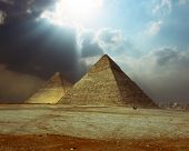 stock photo of the great pyramids  - Sunlight over grate Giza pyramids - JPG