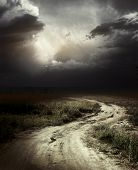 picture of storms  - Rural road and dark storm clouds - JPG