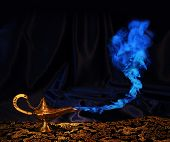 stock photo of genie  - magic Aladdin genie lamp with blue smoke - JPG