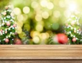Brown Wood Table Top With Abstract Blur Christmas Tree Background With Bokeh Light,holiday Backdrop, poster