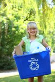 stock photo of recycling bin  - Young girl with recycle bin - JPG