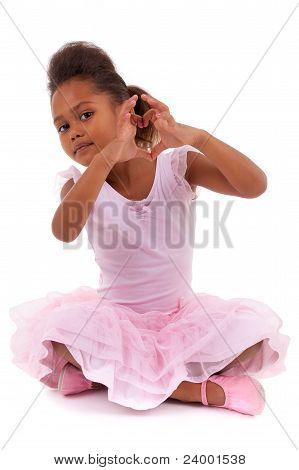 Cute Little African Asian Girl Sitting On The Floor